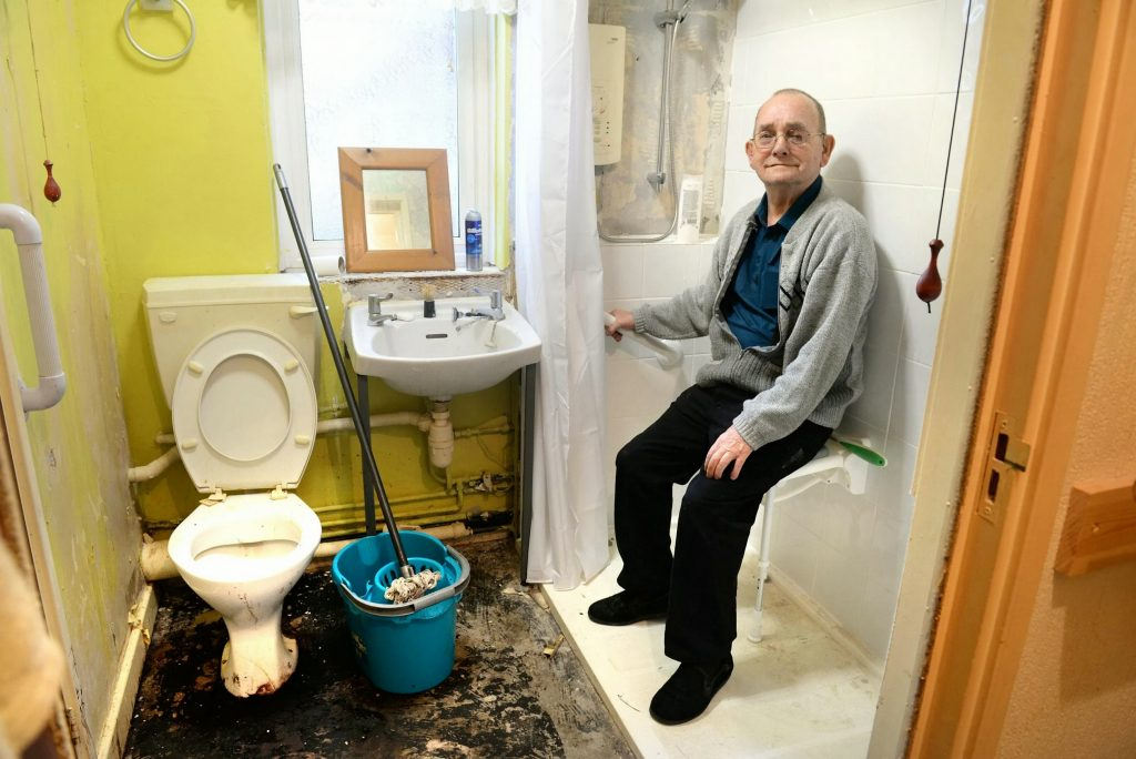 Adam Mohammed of Kinross Close, Blackburn, complaining about the state of his bathroom.