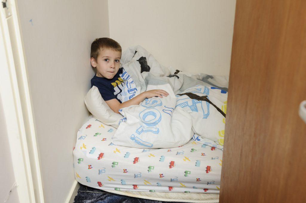 Lucas-James Weston in his cupboard bedroom in Swanley, south east London.