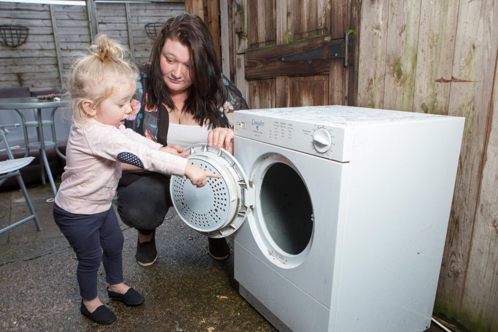 Shannon Johnstone-Evans with daughter Iiylah-Louise at home in Somercotes, Derby.