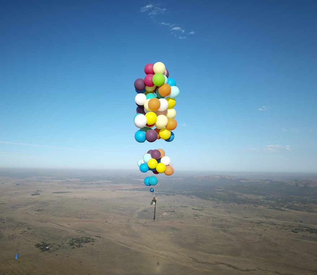 These amazing photographs show the moment a thrill-seeker floated from 100 helium balloons above South Africa while strapped to a camping chair.